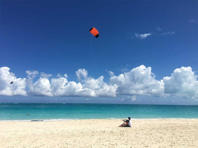 Person Flying a Kite on the Beach