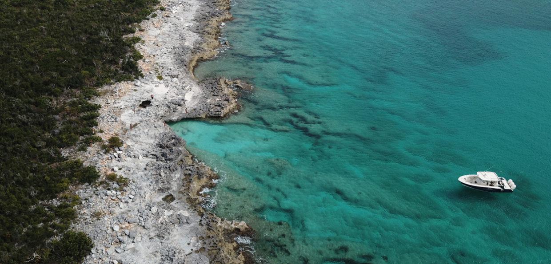 Wide Overhead View of Navis Vessel Along Rocky Shore